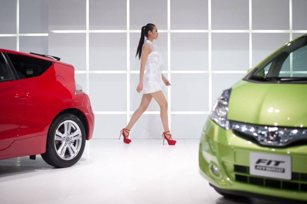 One of the best used cars, the 2012 Honda Fit hatchback, in red and green on display