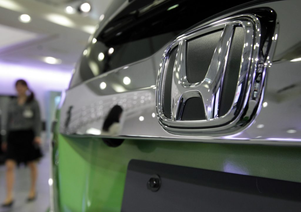 A closeup of the bumper of a green 2012 Honda Fit, one of the best used cars