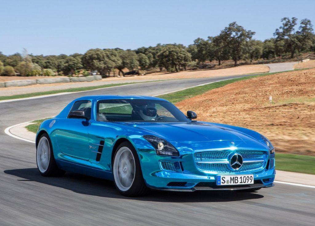 A metallic-blue 2014 Mercedes-Benz SLS AMG Electric Drive drives around a racetrack