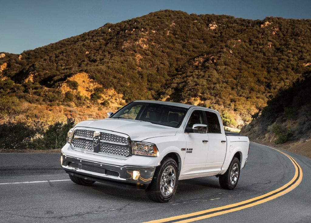A white 2014 Ram 1500 EcoDiesel on a desert mountain road