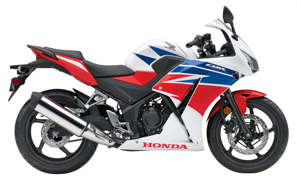 The side view of a white-red-and-blue 2015 Honda CBR300R