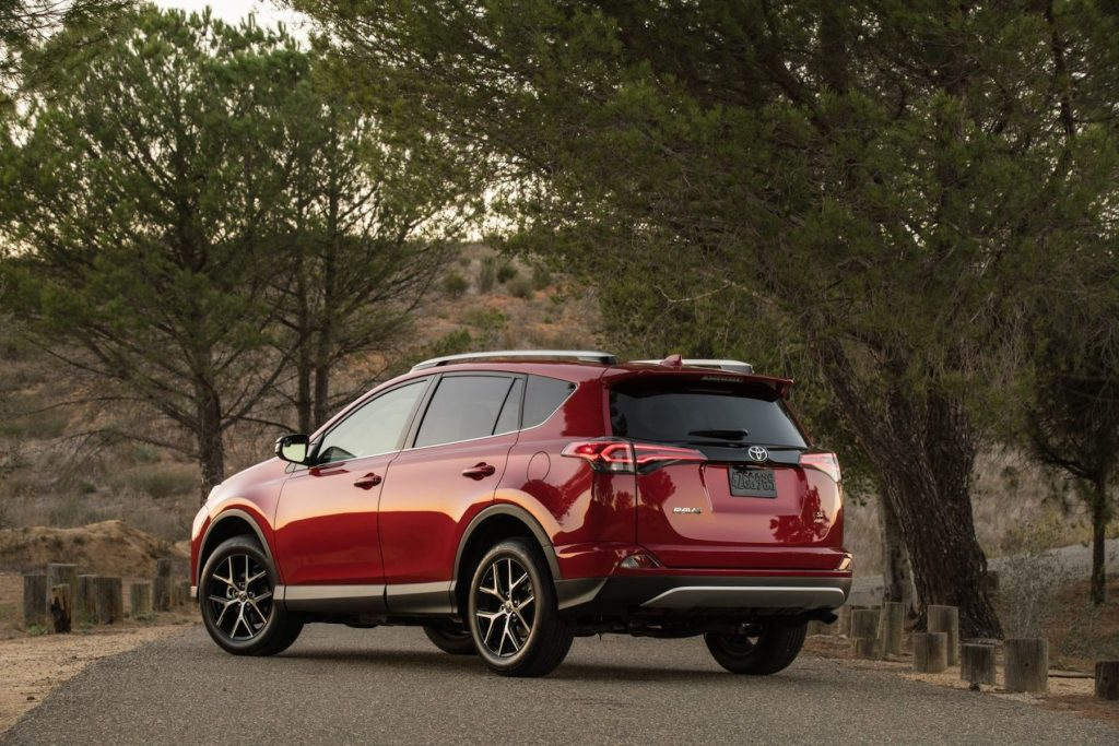 2016 Toyota Rav4 in red parked on the road