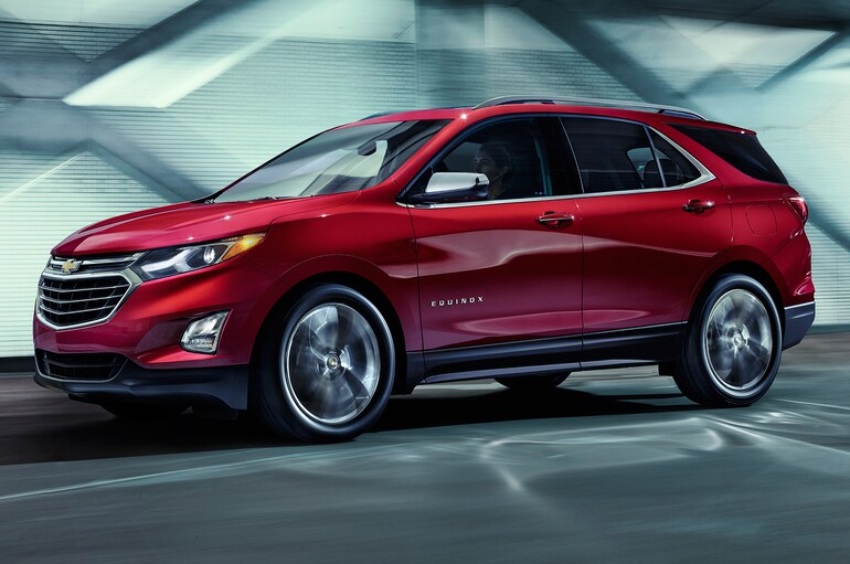The 2018 Chevy Equinox driving on the road