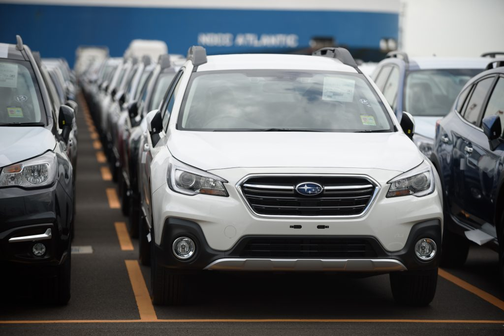 a parking lot full of 2018 Subaru Outback SUVs. Consumer Reports named this model one of the most reliable SUVs of 2018