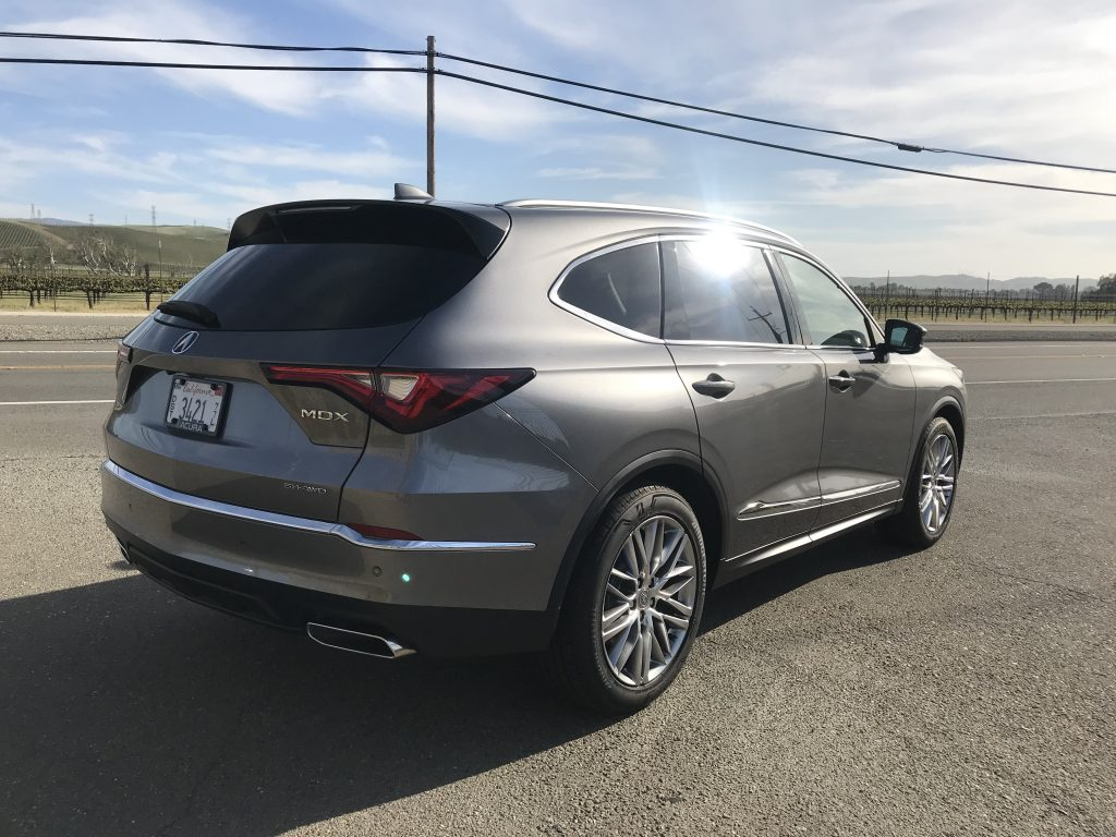 A rear shot of the 2022 Acura MDX in silver