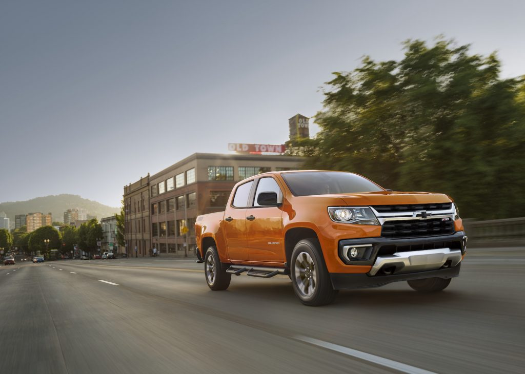 An orange 2021 Chevrolet Colorado Z71 driving