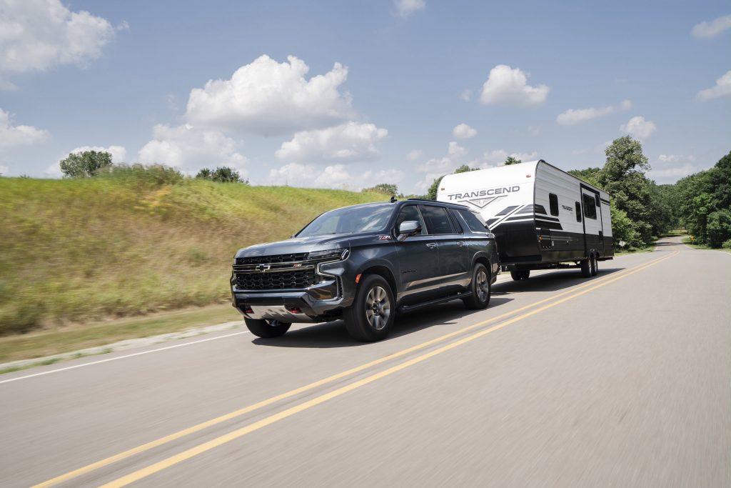 2021 Chevrolet Suburban Z71 hauling a trailer down the road