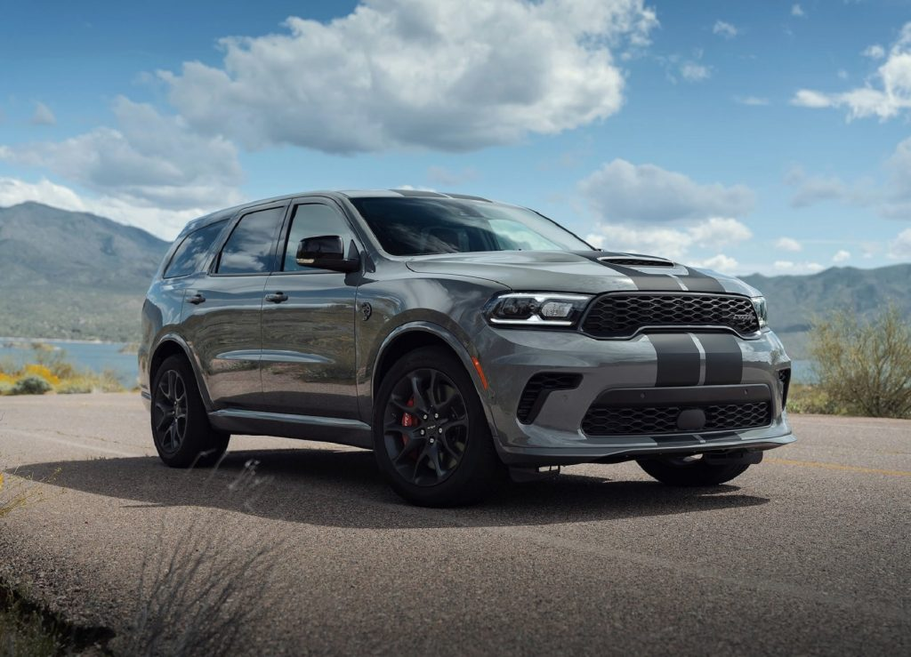 A gray-with-black-stripes 2021 Dodge Durango SRT Hellcat parked by a mountain lake