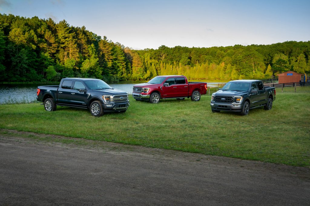 Left to right: 2021 Ford F-150 Limited in Smoked Quartz Tinted Clearcoat, F-150 Lariat in Rapid Red Metallic Tinted Clearcoat, and F-150 XLT Sport Appearance Package in Carbonized Gray.