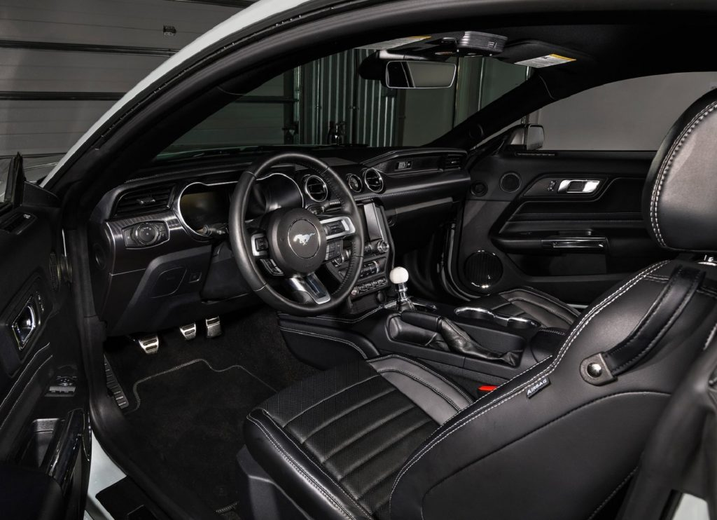 The black interior of a 2021 Ford Mustang Mach 1 with a manual