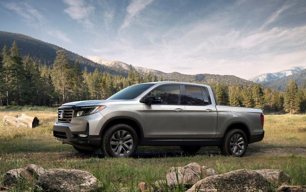 A silver 2021 Honda Ridgeline parked on a grassy hill