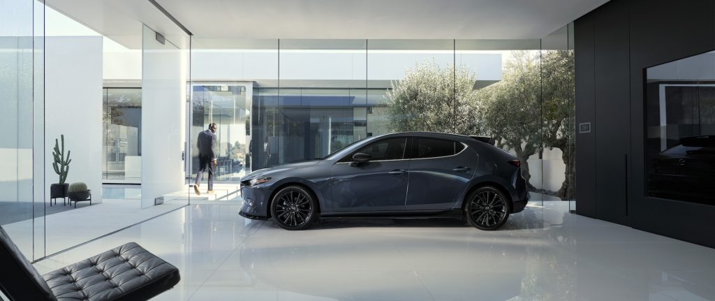 a side shot of the 2021 Mazda3 Hatchback in a showroom