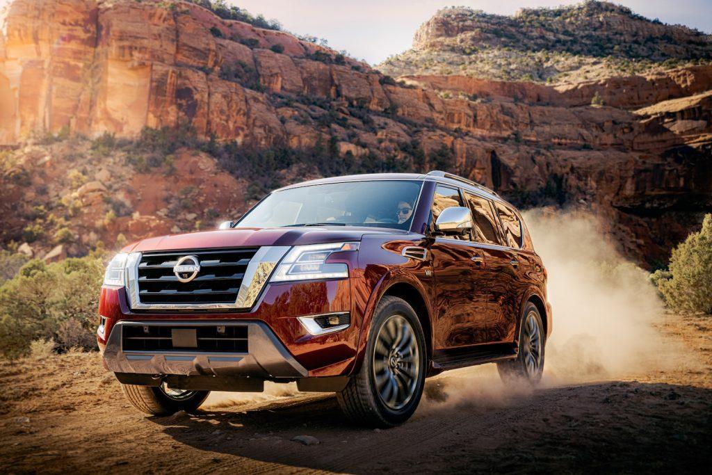 2021 Nissan Armada driving up a dirt hill