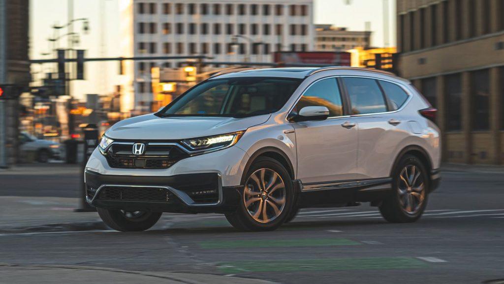 The 2021 Honda CR-V Hybrid driving in the city