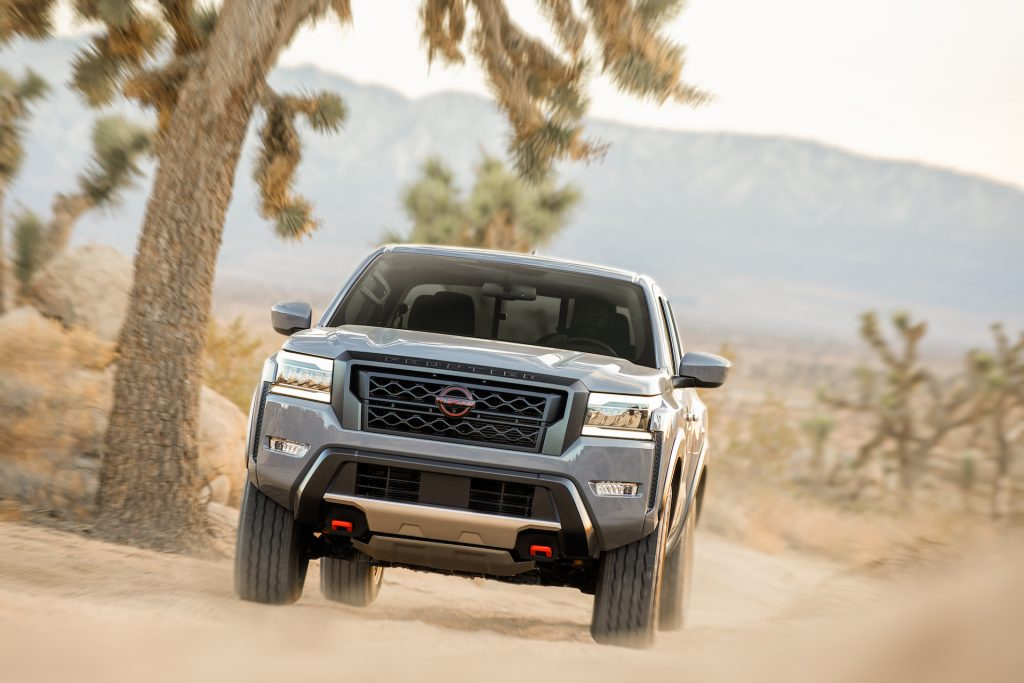 The resale value of a 2022 Nissan Frontier, like this one driving in the desert, is estimated to be higher than most other vehicles'