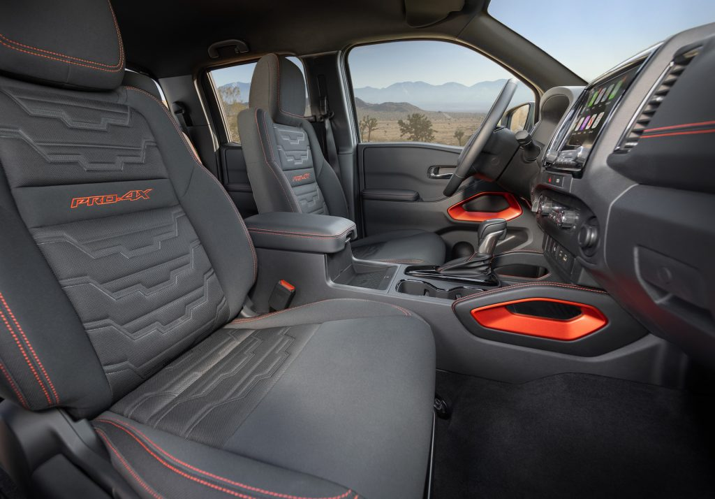 An image of a 2022 Nissan Frontier parked outdoors.