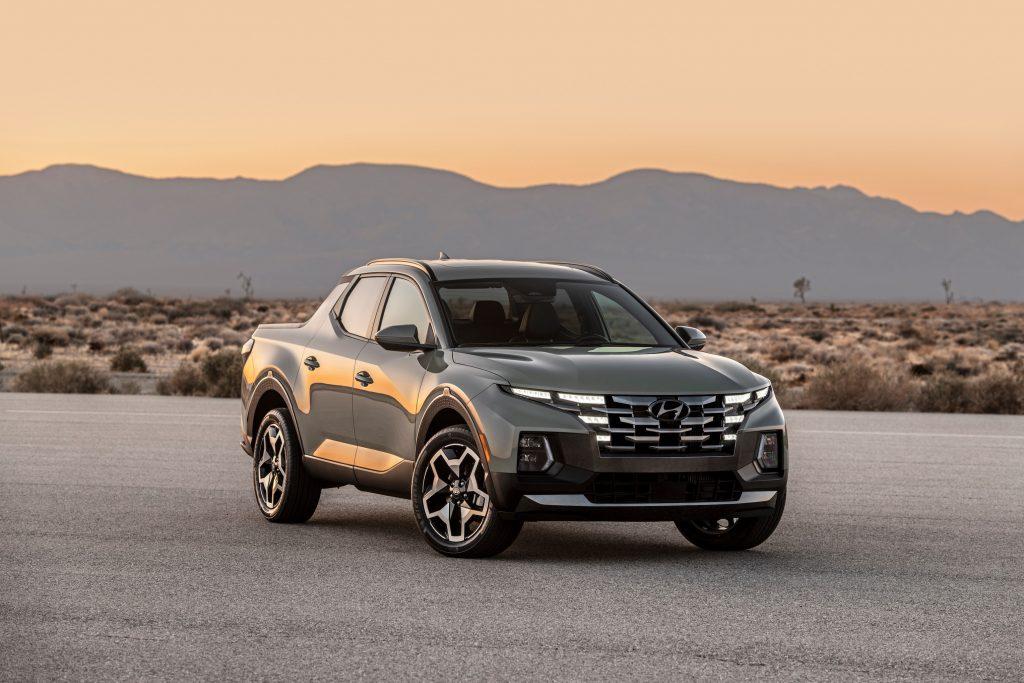 A silver 2022 Hyundai Santa Cruz parked in the desert while the sun sets