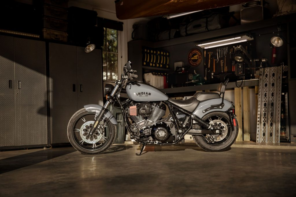 A gray 2022 Indian Chief Dark Horse with Rogue Collection accessories in a garage