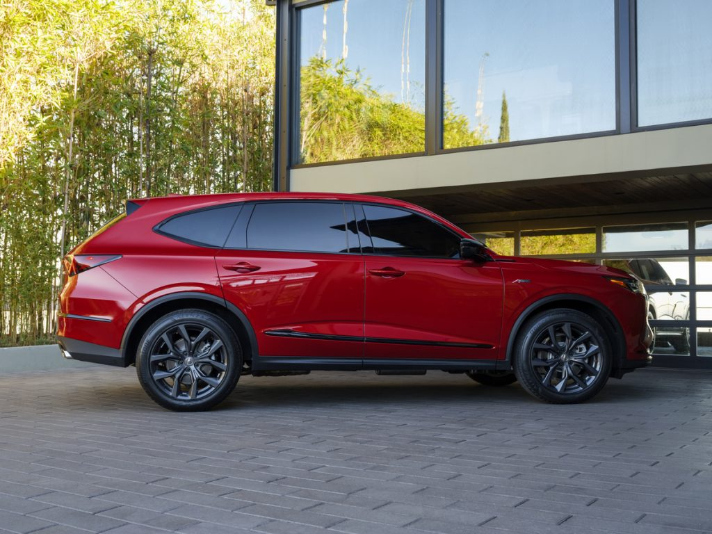 A side shot of the 2022 Acura MDX A-Spec in red