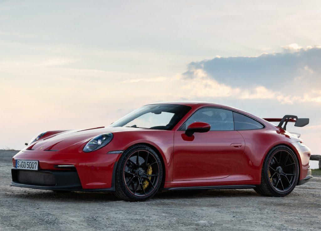 A red 2022 Porsche 911 GT3 parked on a gravel lot