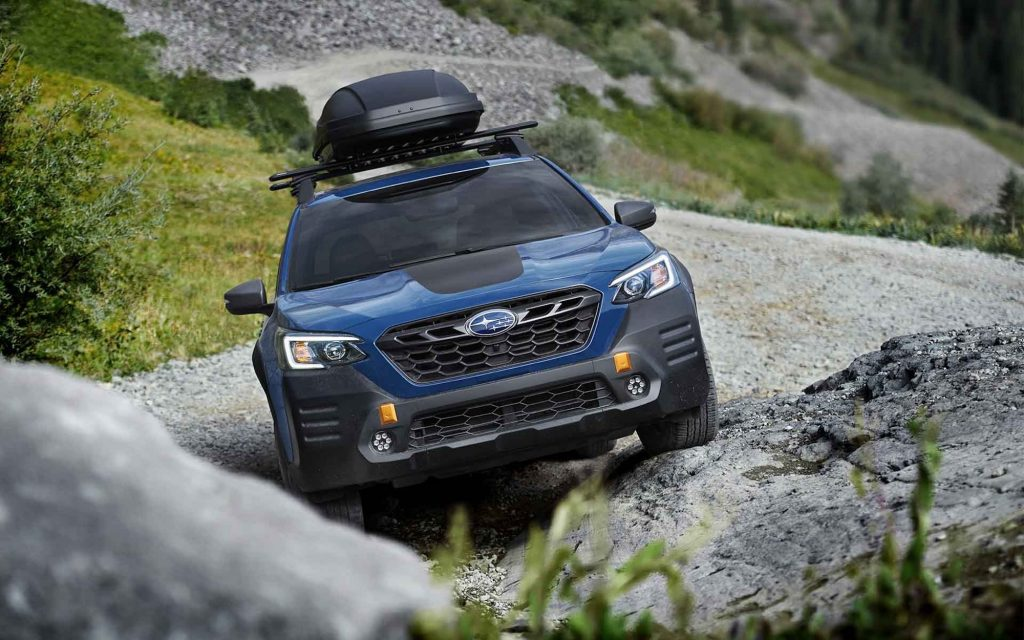 2022 Subaru Outback Wilderness Edition driving up a craggy rock