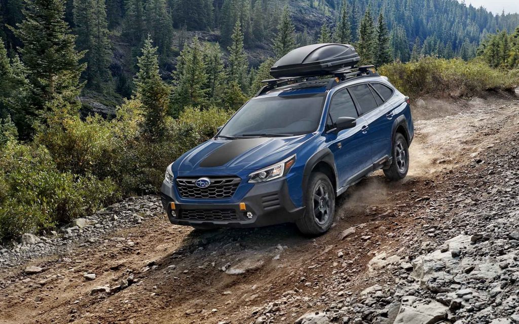 2022 Subaru Outback Wilderness Edition driving down a dirt trail