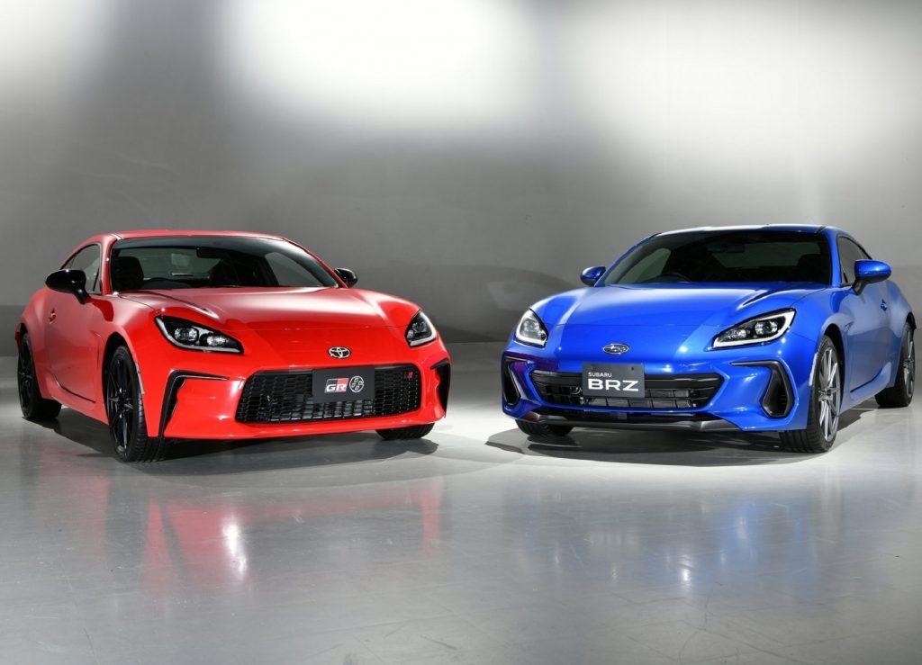 A red 2022 Toyota GR 86 next to a blue 2022 Subaru BRZ