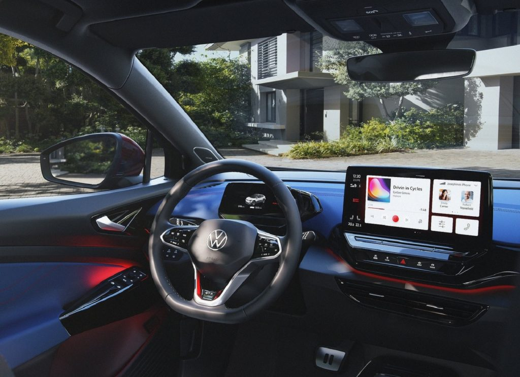 The driver's-side of the red-and-blue-trimmed interior of the 2022 Volkswagen ID.4 GTX