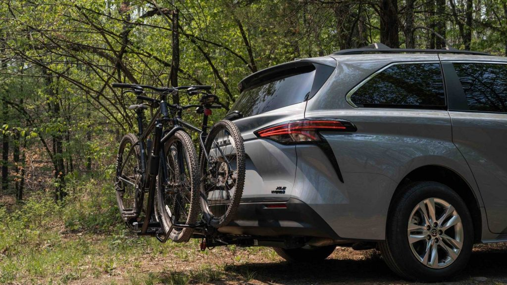 rear 3/4 view of 2022 Sienna Woodland special Edition with bikes on a bike rack