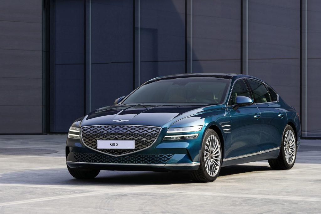 An image of a Genesis Electrified G80 parked outside.