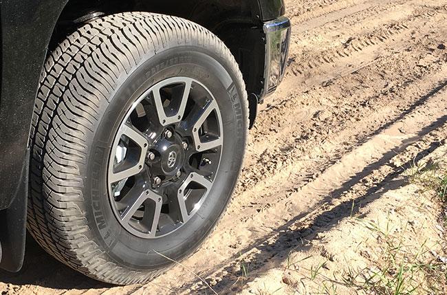 A truck running michelin LTX A/T 2 tires in the dirt