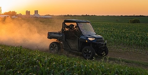 a Polaris Ranger driving between to corn fields is a side-by-side from the most popular ATV and UTV brand