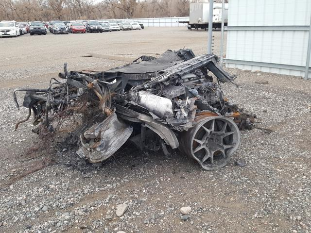 An image of a destroyed Ford GT at a Copart auction.
