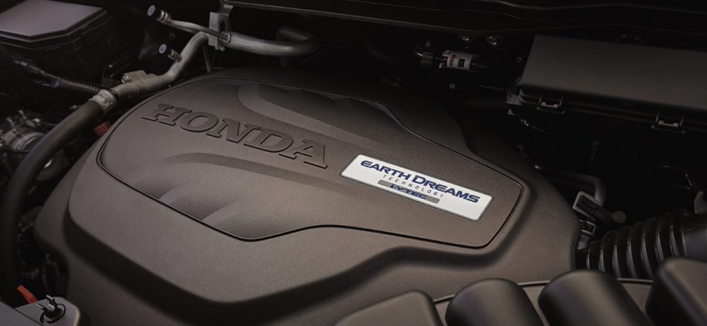 A close up view of the V6 engine under the hood of the 2021 Honda Passport