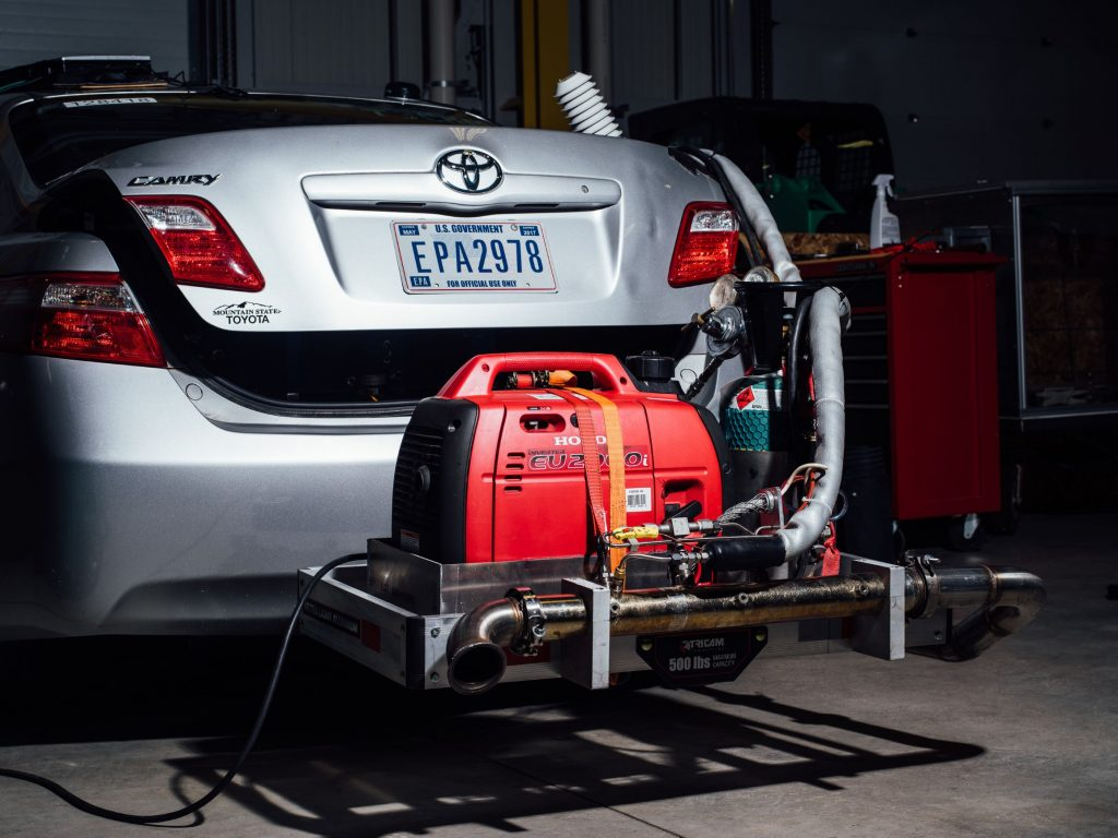A silver Toyota Camry undergoing emissions tests at an EPA facility