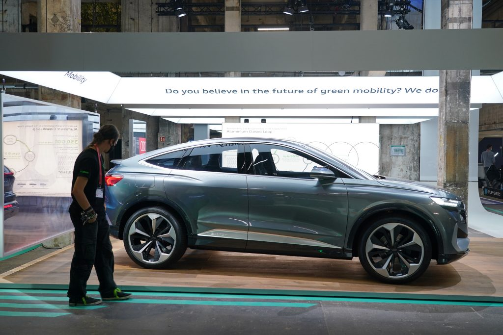 A gray Audi Q4 e-tron electric car stands on display at a press preview at the Greentech Festival