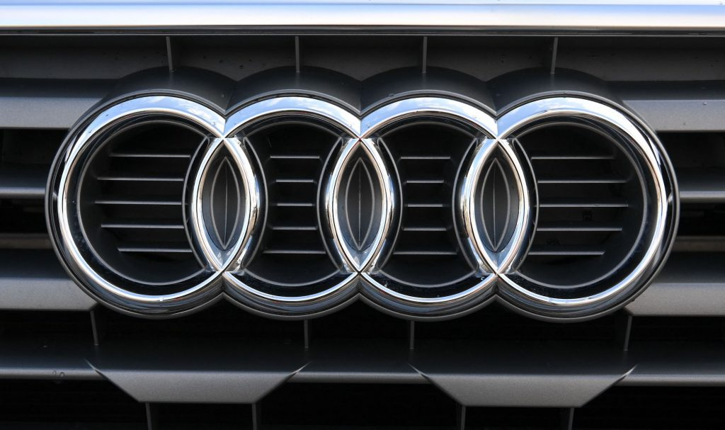 The silver logo of the German automaker Audi is seen on a car's grille on March 18, 2021, at its headquarters in Ingolstadt, Germany