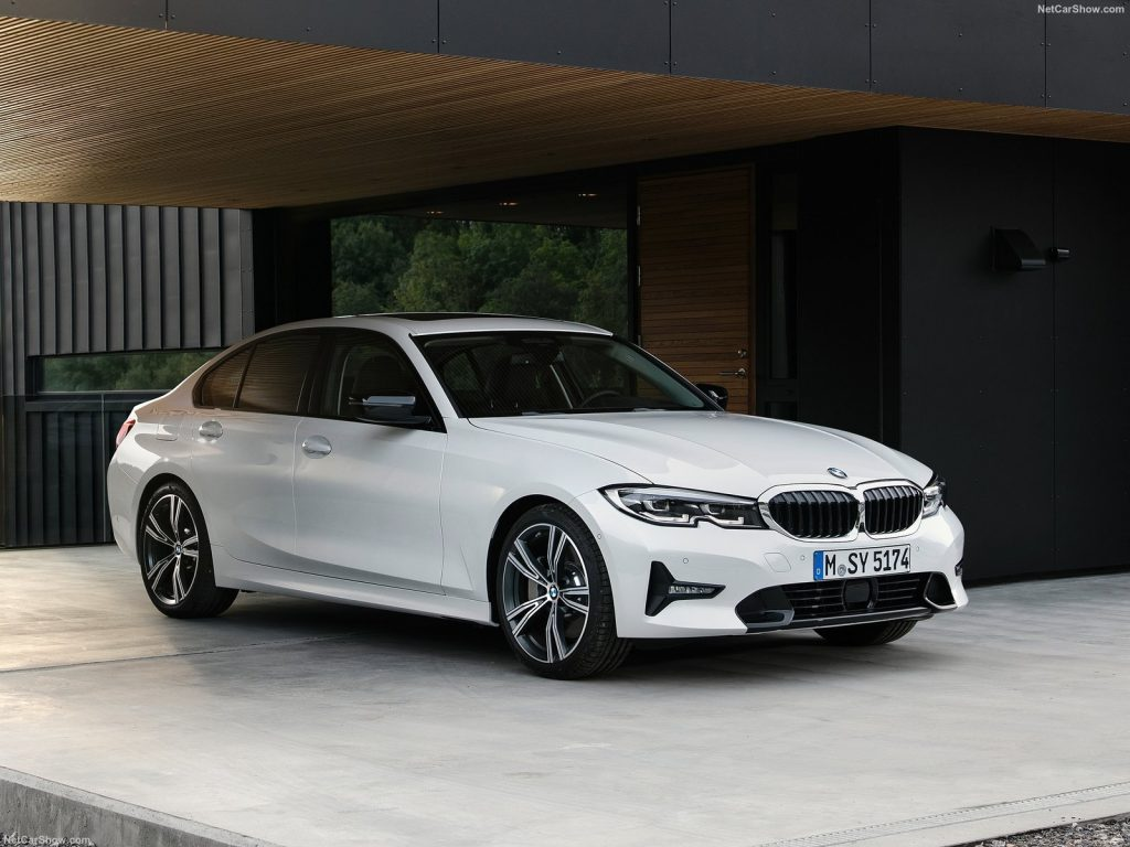 An image of a BMW 3-Series parked outdoors.