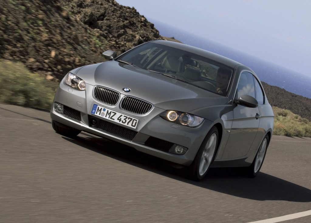 A front shot of a 2008 BMW 328i driving