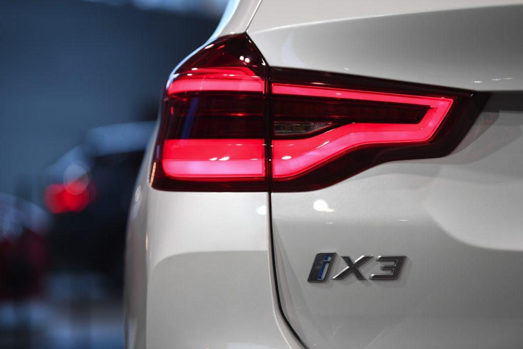 A white BMW iX3 electric vehicle