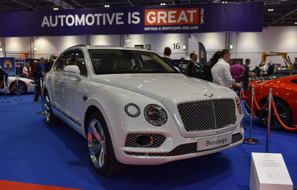 A white Bentley Bentayga Hybrid is displayed during the London Motor Show at ExCel