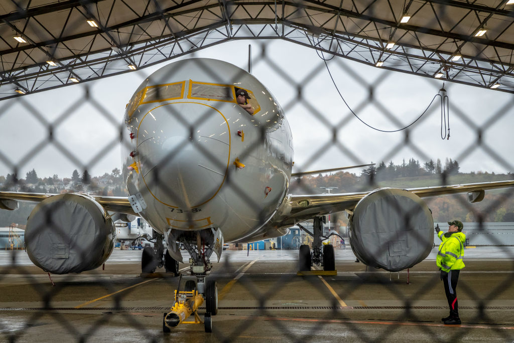 Boeing 737 Max plane behind fence