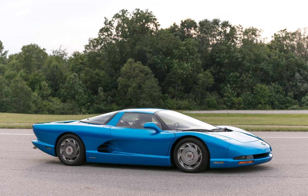 An image of a Mid-Engined Chevrolet Corvette concept parked outdoors.