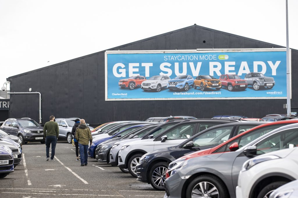 Potential customers walk around Charles Hurst Usedirect used car dealership on Boucher Road in Belfast as restrictions in Northern Ireland ease allowing new and used cars sales