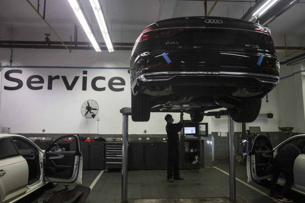 A car goes in for repairs at a shop