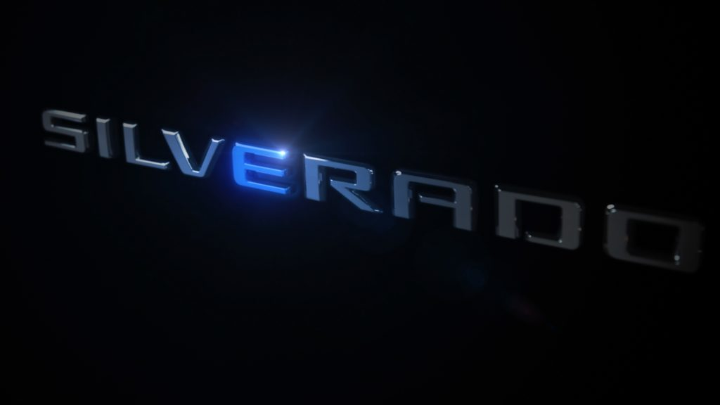 The word Silverado in silver against a black background. The letter E is emphasized in blue.