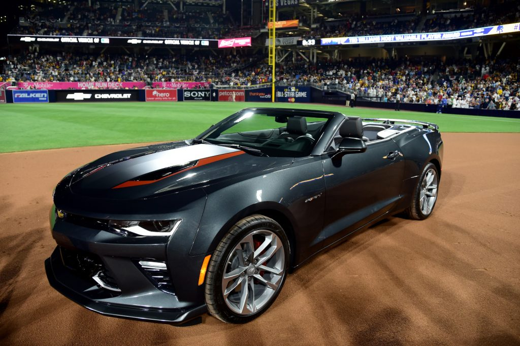 A Chevy Camaro SS sits on a baseball field