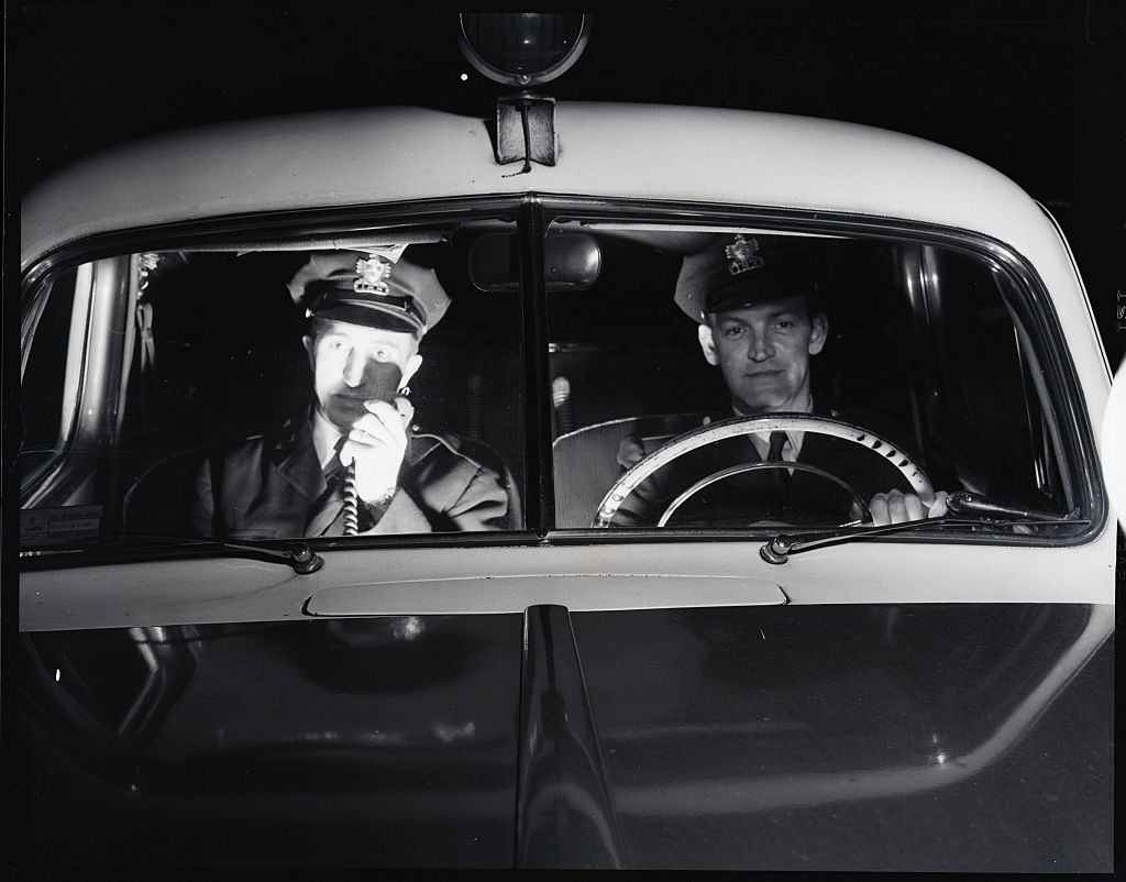 1950s police in squad car