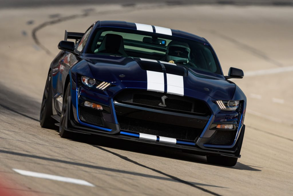 a dark blue 2021 Ford Mustang Shelby GT500 on the track