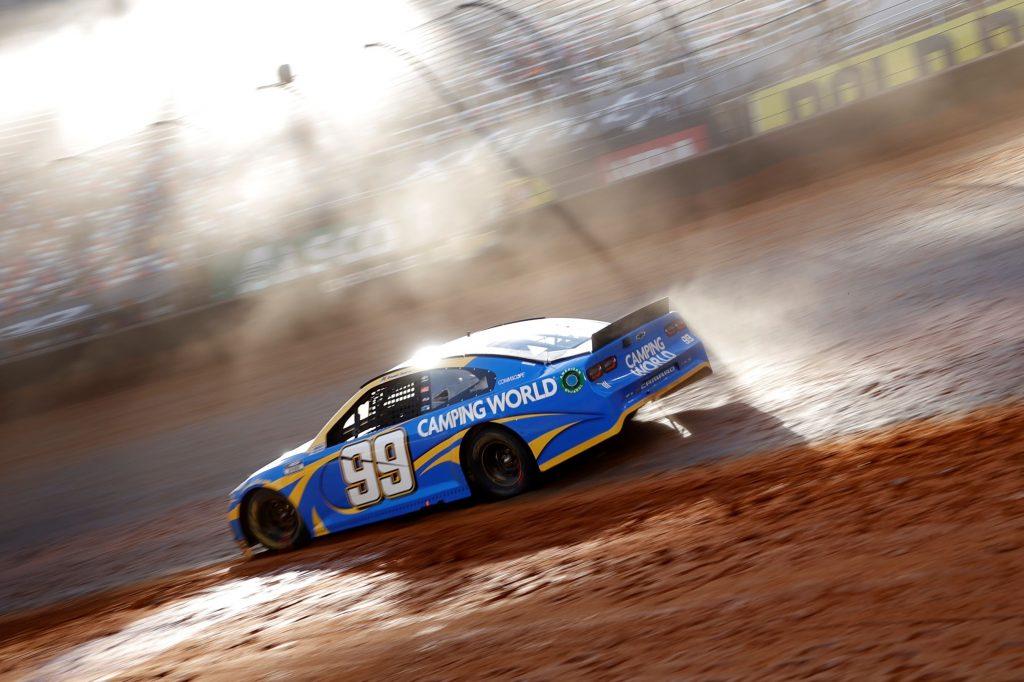 Daniel Suarez slides the blue #99 Chevrolet at the 2021 NASCAR Cup Series Food City Dirt Race at Bristol